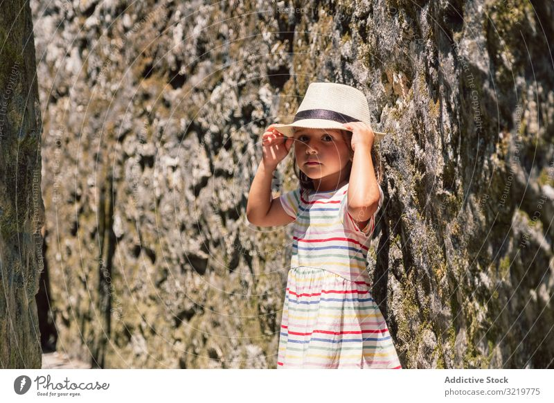 Girl in narrow stone walkway girl adventure happy walking sunlight wall travel tourist nature summer holiday child architecture building destination old
