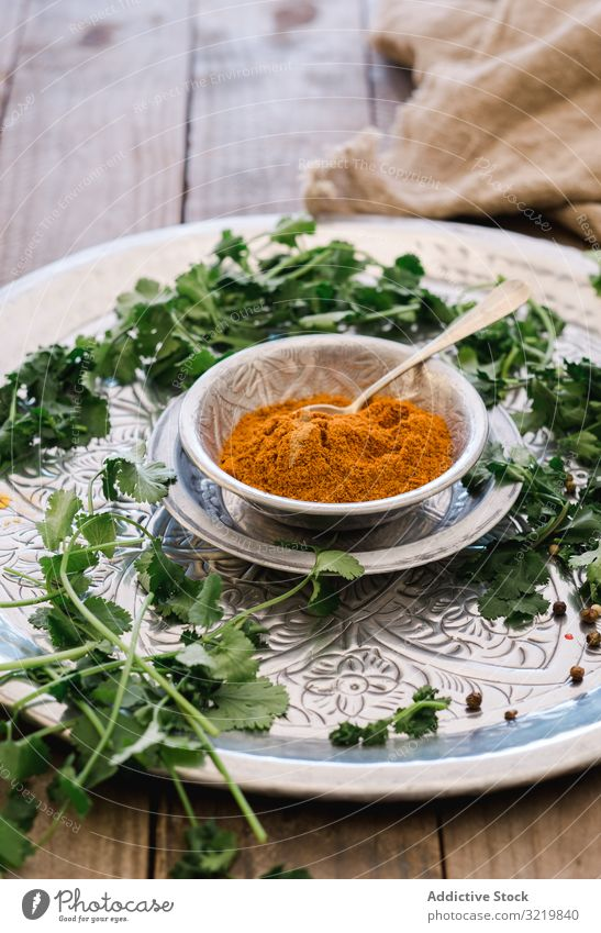 Turmeric in silver bowl with herbs on table turmeric spice food green fresh organic spicy diet herbal ingredient condiment dish cuisine asian recipe powder