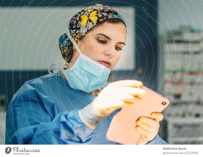 Female doctor standing with smartphone surgeon taking photo woman medicine hospital using operation surgery clinic young female serious beautiful attractive