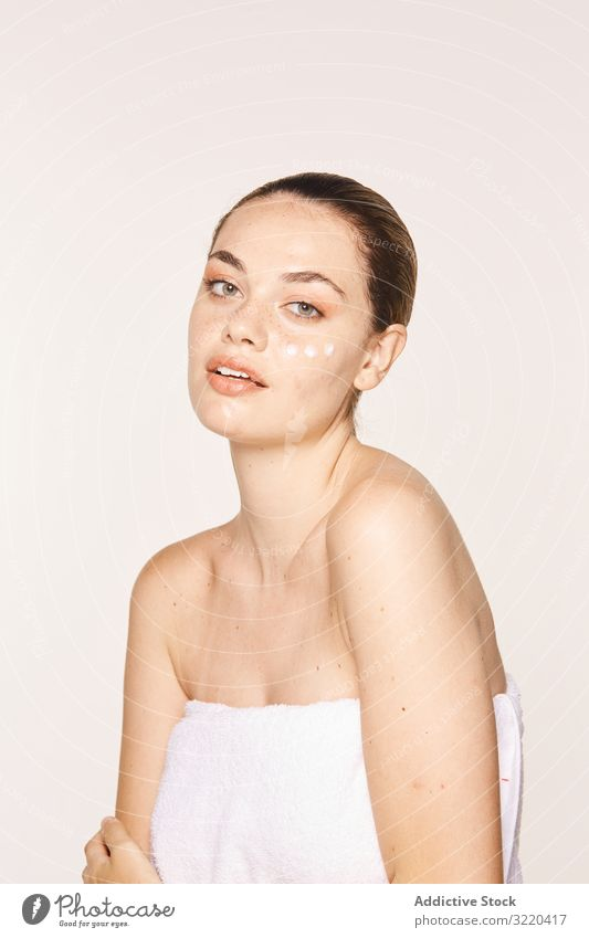 Pretty woman with cream on face care skin luxury cosmetic cosmetology graceful amiable pure pose female apply body model naked beautiful sensual healthy