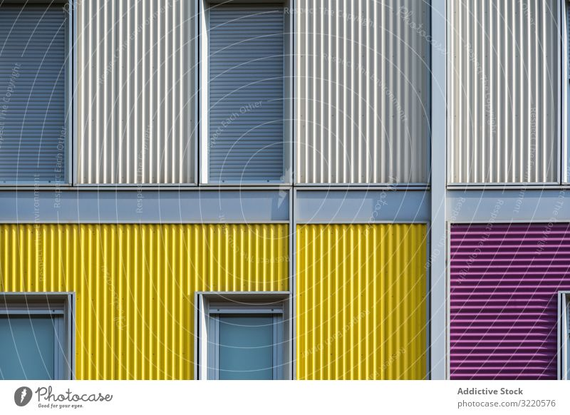 Facade of modern multicolored building with narrow windows exterior colorful architecture facade house property construction investment estate residential