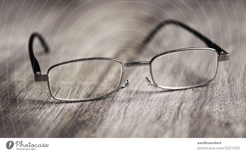 reading glasses Health care Help Eyeglasses Reading glasses Looking Optics Optician Lens visually impaired Sign of old age presbyopia Table Wooden table