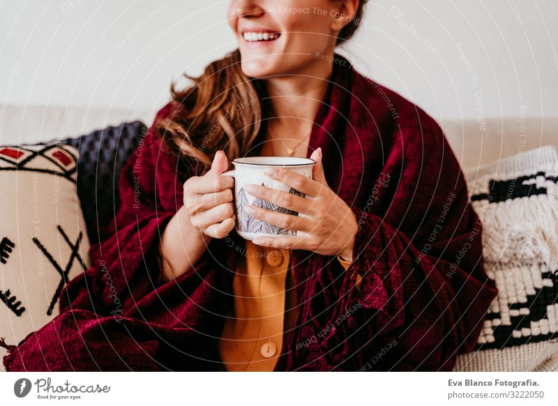 beautiful woman sitting on the sofa, enjoying a cup of tea. lifestyle indoors, autumn season Woman Tea Coffee Home Morning Caucasian Lifestyle Interior shot