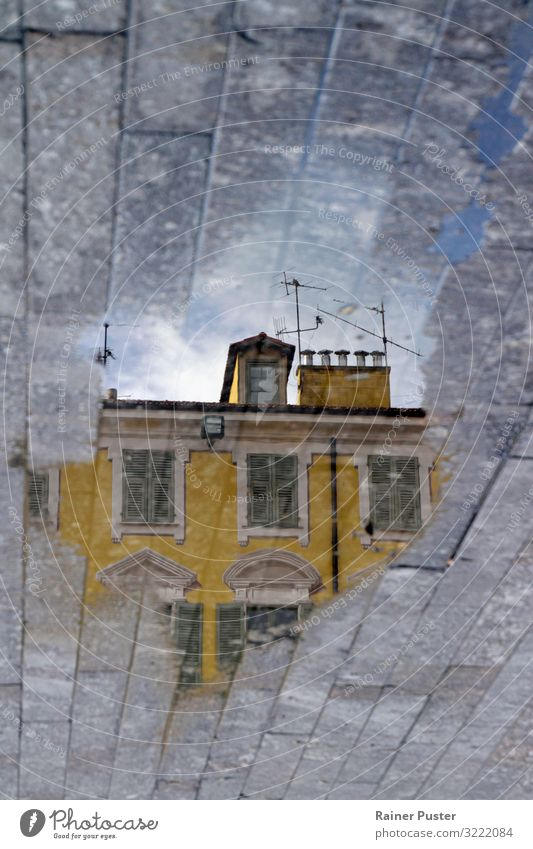 Mirror world: building reflected in a puddle Rain Puddle Nice Downtown Exceptional Wet Blue Yellow Gray Optimism Expectation Idyll Reflection Colour photo