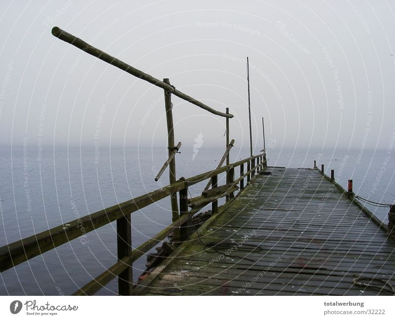 Boat landing stage in the fog Watercraft Footbridge Fog Cold Moody Loneliness Rügen