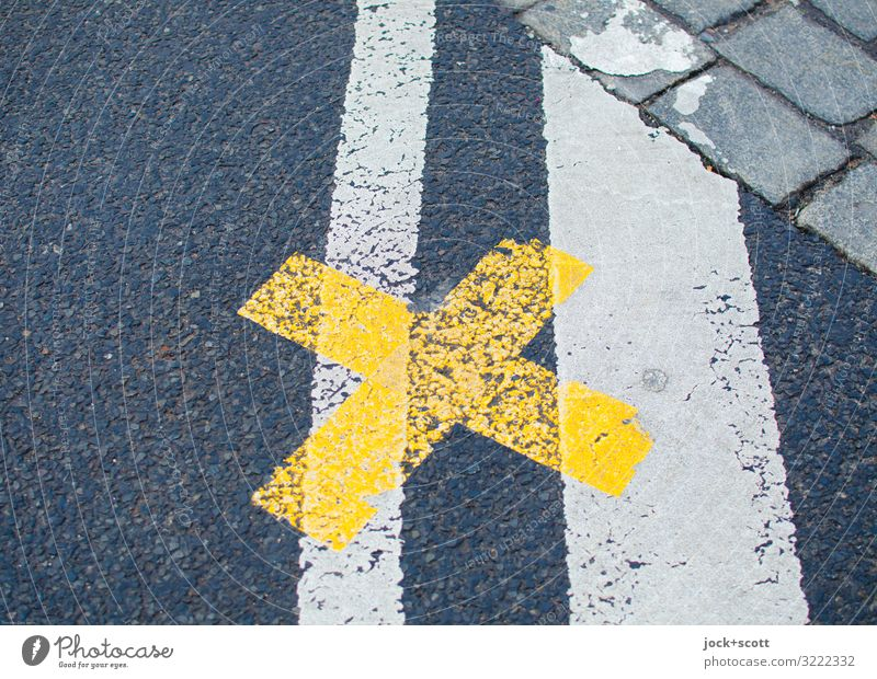 right here at the cross on the road Traffic infrastructure Street Traffic regulation Lane markings Asphalt Cobblestones Crucifix Line Authentic Under Yellow
