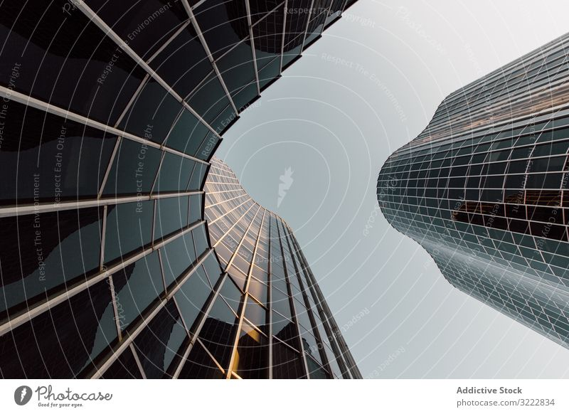 Round geometric building of business center with mirrored walls futuristic architecture development urban construction structure office reflection design