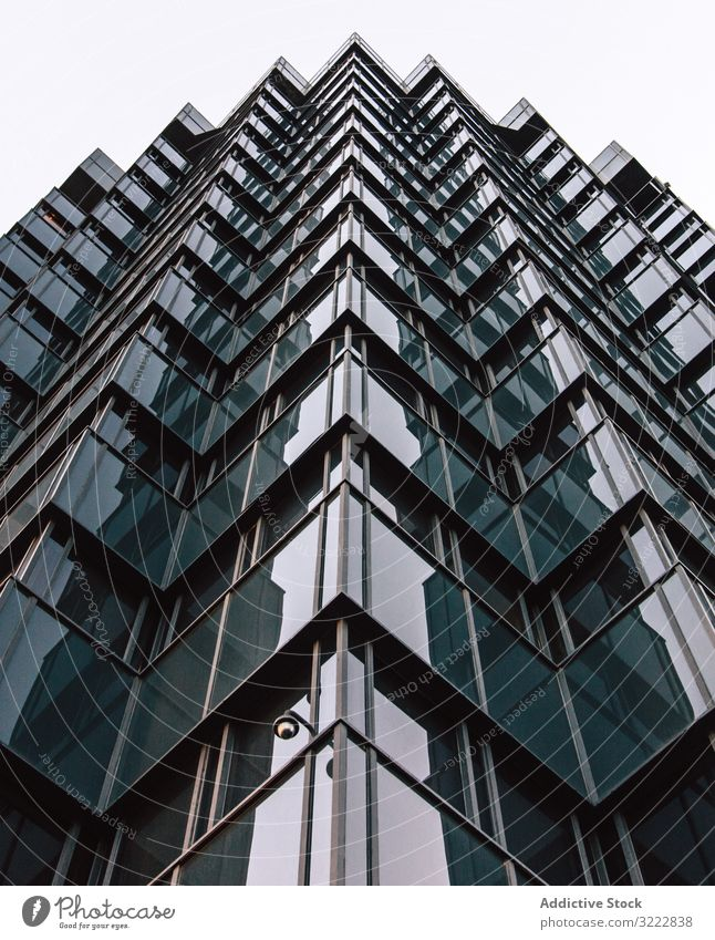 Geometric building of business center with mirrored walls geometric architecture high rise urban construction perspective exterior structure office reflection