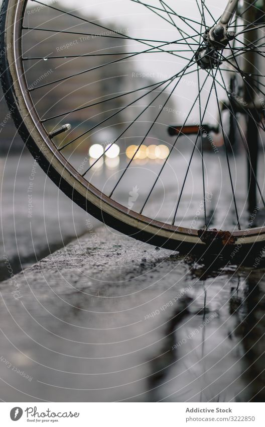 Wet bicycle wheel on road rain architecture activity wet bike cycling travel journey freedom adventure repair vehicle extreme dirty transport traffic waiting