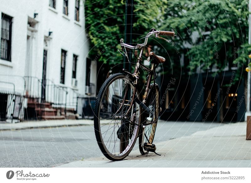 Bicycle parked on New York street bicycle sidewalk urban suburb pavement ride transportation lifestyle new york city tourism travel trip journey left nyc road
