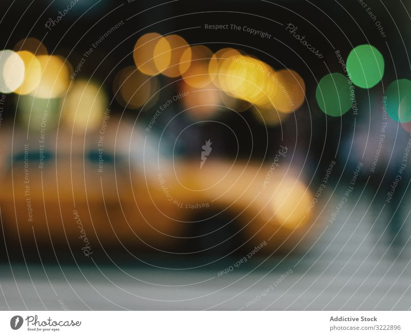 Yellow taxi and evening city lights defocused cityscape traffic new york america car street motion road blurred bokeh unfocused abstract illuminated urban nyc