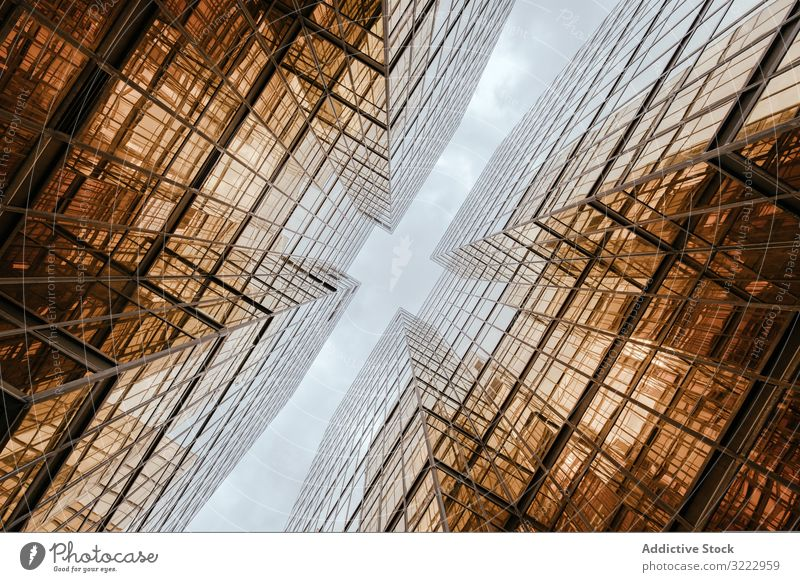 Buildings reflecting each other in wide windows facade downtown center business architecture futuristic urban building city corporate office sky exterior modern