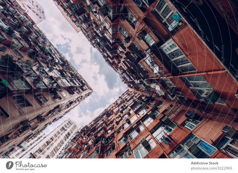 Contemporary buildings with balcony standing near facade architecture urban city sky exterior modern contemporary district construction wall outside cloud house
