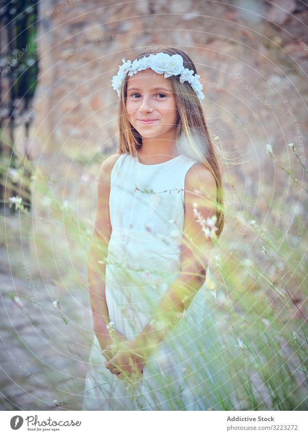 Small cute girl in elegant dress and flower headband child beauty little adorable kid innocence pensive female purity individuality comely sweet hair positive