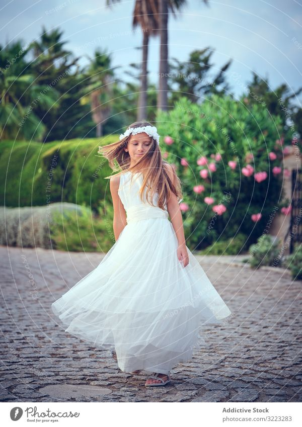 Adorable little girl in airy dress dancing in park child spinning leisure enjoyment happy sweet kid adorable female cute beautiful innocence purity