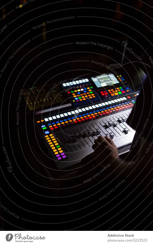 Sound mixer during a night concert man switch buttons volume digital electronic panel equalizer media board technology audio professional control equipment
