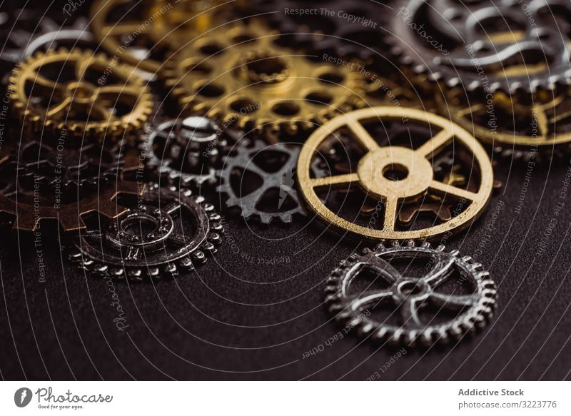 Shiny gears of cold steel colors on dark background steampunk watch texture machine industrial mechanism mechanical grunge metal device futuristic mysterious