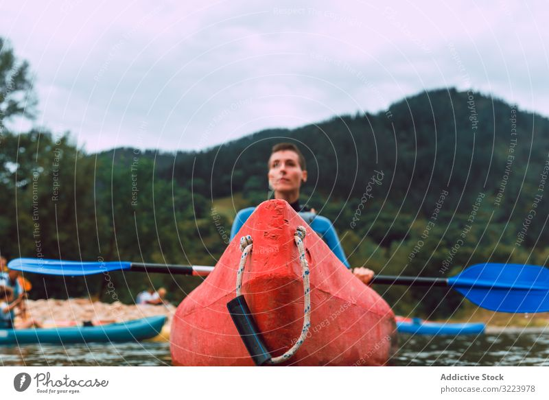 Young female kayaking on nature background woman paddle sport sella river spain adventure activity water tourism canoe lifestyle travel concentrated serious
