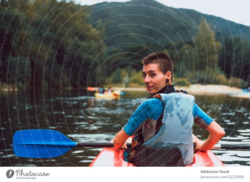 Female kayaking with paddle in raised hands woman winner competition sport sella river spain water canoe activity tourism adventure lifestyle travel female