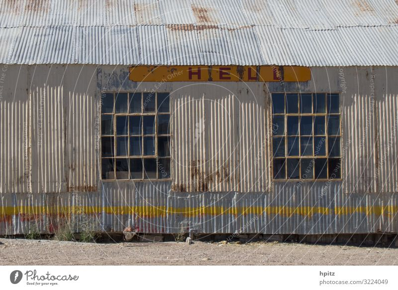 H E L L L Hut Industrial plant Building Facade Metal Rust Characters Signage Warning sign Line Old Creepy Broken Retro Trashy Yellow Gray White Crisis