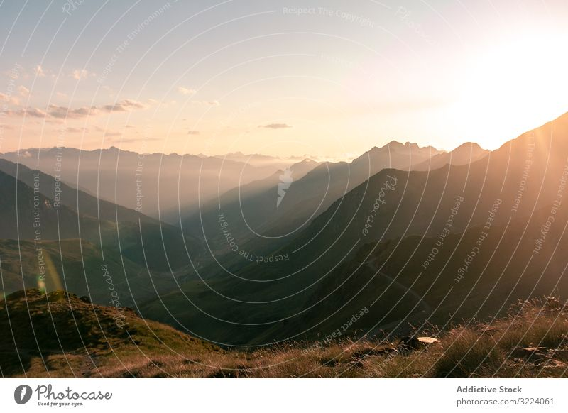 Mysterious mountain high in row in sunlight fog nature travel landscape sky rural mist way path trip scenic journey countryside weather foggy route freedom