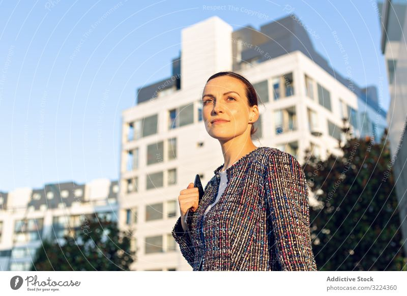 Serious businesswoman leaning on railing building street office serious city elegant modern urban female concerned manager entrepreneur career exterior jacket