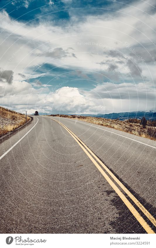 Empty road in Grand Teton National Park, Wyoming, USA. Vacation & Travel Tourism Trip Adventure Far-off places Freedom Cycling tour Mountain Landscape Sky