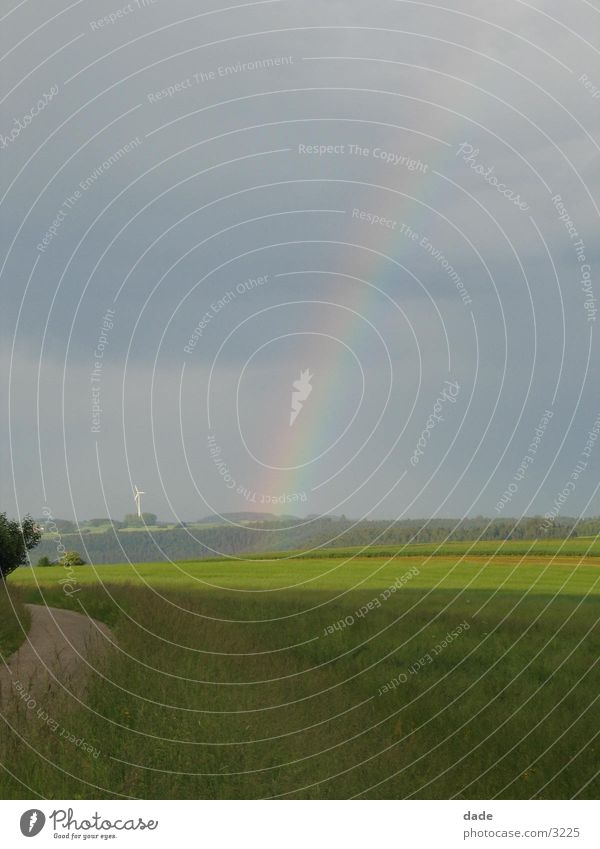 Sky Far-off places Landscape Horizon Field Rainbow Refraction Natural phenomenon Clouds in the sky Cloud cover