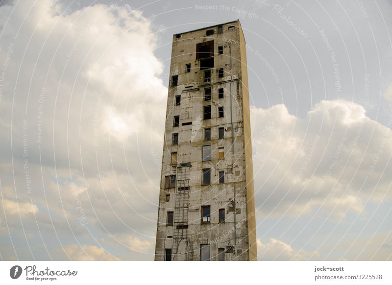 a tower like no other lost places Clouds Tower built Dismantling Window Concrete Sharp-edged Hideous Tall Broken Long Gloomy Moody Apocalyptic sentiment
