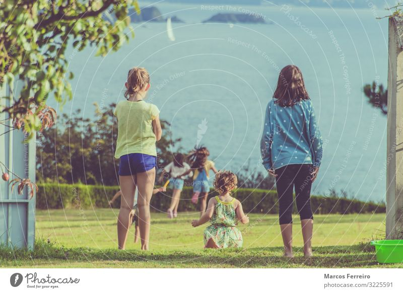 children playing in the garden Child Human being Nature Water Joy Girl Healthy Coast Boy (child) Garden Playing Group Together Friendship Body Field