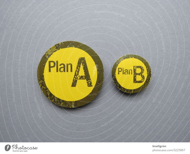 Plan A Plan B Characters Signs and labeling Communicate Yellow Gray Black Flexible Problem solving Fiasco Planning Rescue Safety Alternative Colour photo