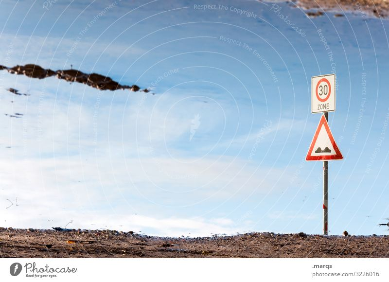 Zone 30 Water Puddle reflection Sky Signs and labeling Road sign traffic-calmed zone Hill Signage disorientation Transport 30 mph zone