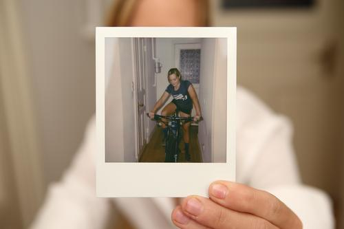 Woman holds Polaroid portrait of herself in camera Style Joy Beautiful Life Flat (apartment) Sports Cycling Photography Instant camera Young woman