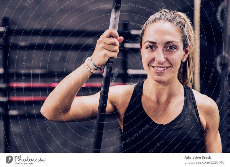 Serene woman relaxing in gym rest pole bar fitness center slender female serene peaceful lifestyle training sport healthy workout sportswear athlete break