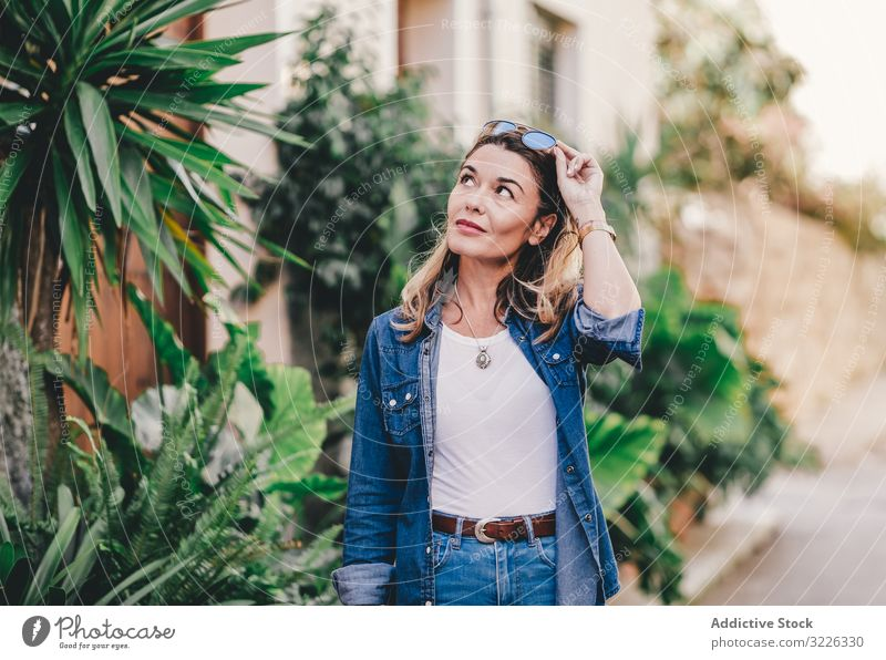 Tourist woman walking on the street smile cheerful happy friendly lifestyle model casual relaxation leisure rest attractive disposable autumn enjoyment beauty