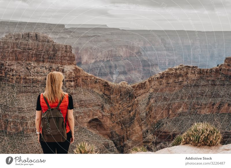 Calm female looking at pictorial landscape woman admire canyon view picturesque calm backpack usa vacation explore holiday tourist freedom carefree travel