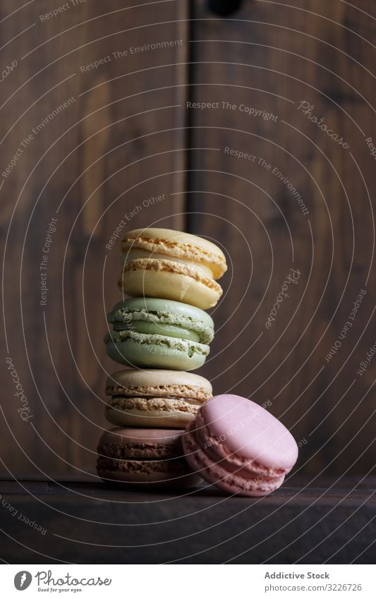 Stack of fresh crunchy macaroons stack dessert colorful snack food wall wooden biscuit sweet gourmet assorted pastry confection traditional delicious tasty