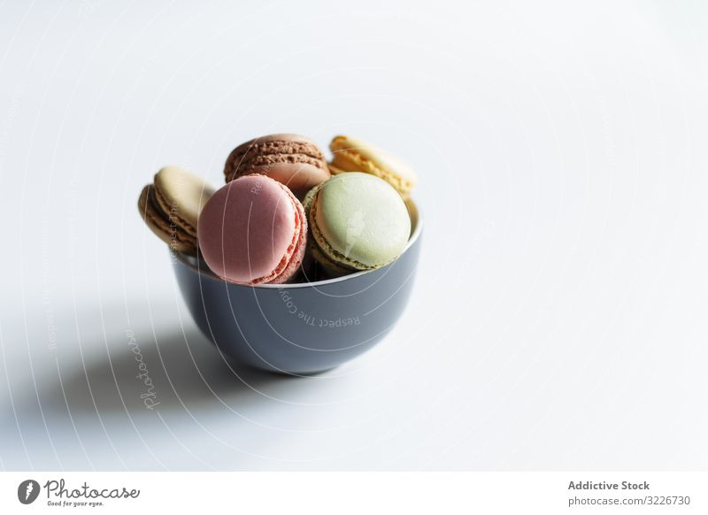 Bowl of colorful macaroons bowl dessert table treat sweet food fresh cuisine yummy delicious tasty scrumptious crunchy calorie snack lumber traditional dish