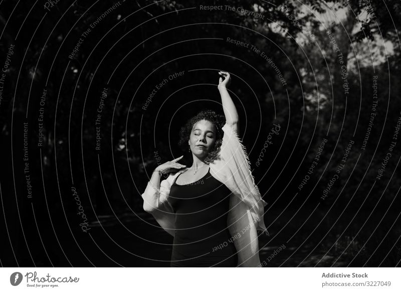 Sensual woman dancing in nature dance raised arm closed eyes sensual tree graceful elegant female countryside forest joy movement motion calm tranquil serene