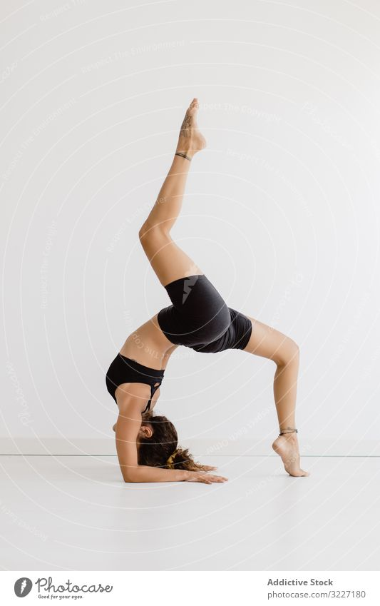 Sportive woman performing yoga pose in room practicing position relaxation exercise beautiful fitness sport leisure female workout meditate wellness sportswear