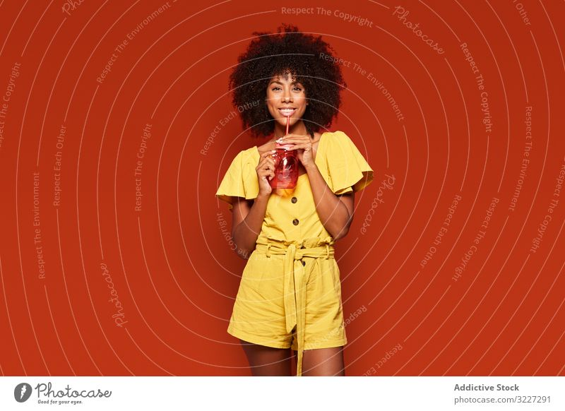 Charming bright black woman drinking beverage dream cocktail charming colorful summer vivid fashion vibrant contemporary curly ethnic african american afro