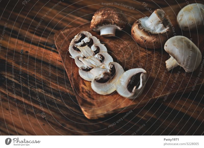 Mushrooms on a wooden chopping board Food Button mushroom Nutrition Organic produce Vegetarian diet Chopping board Fresh Delicious Brown To enjoy