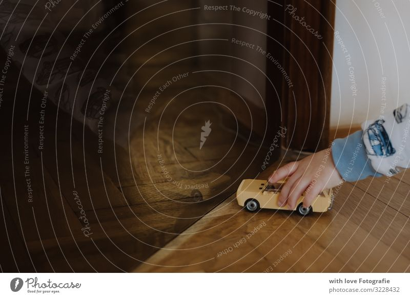 Feeling of the game Playing Human being Masculine Toddler Boy (child) Infancy Hand 1 1 - 3 years Toys Utilize Toy car Dark Colour photo Interior shot Close-up