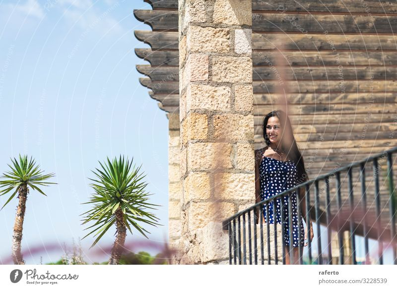 Beautiful hispanic woman in blue dress leaning on wall Woman Human being Nature Youth (Young adults) Young woman Summer 18 - 30 years Face Street Lifestyle