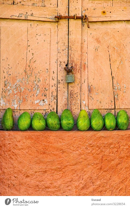 lined mangos placed in a window, trinidad - cuba Fruit Life Island Building Facade Street Sell Fresh Colour Mango exterior Cuba caribe Placed Shutter