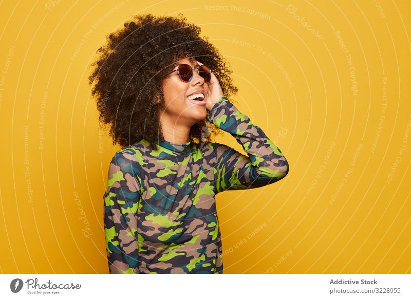 Trendy ethnic lady in sunglasses on bright backdrop woman colorful cool afro trendy vibrant happy vivid outfit modern hipster millennial attractive black