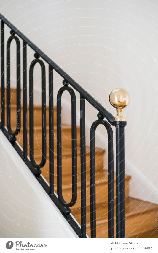 Classic wooden staircase with wide wooden steps classic design villa mansion estate handrail railing house interior light black home new elegant contemporary