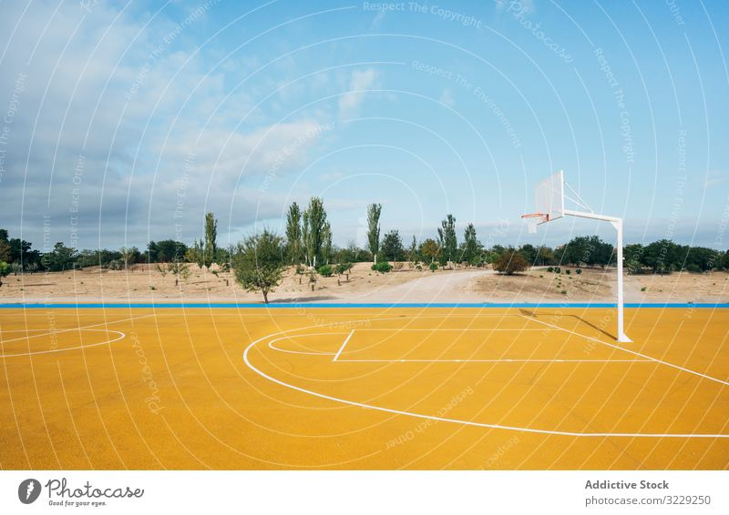 yellow basketball court outdoor. competition recreation action portrait active activity asphalt athletic city drop drops energy ethnicity exercise game leisure