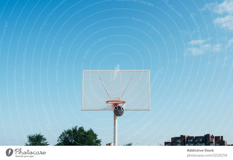 ball into basket in Outdoor basketball court and black ball man athlete competition sports equipment adult recreation action portrait active activity asphalt