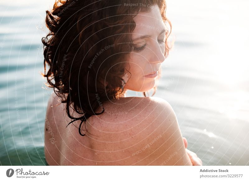 Sensual woman in sea water sensual clean summer vacation tender sunny daytime female nude topless harmony idyllic rest relax calm tranquil serene peaceful lady